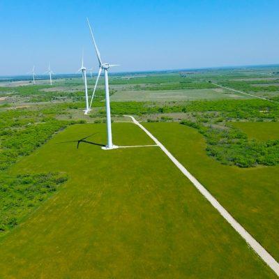Windturbines over green fields
